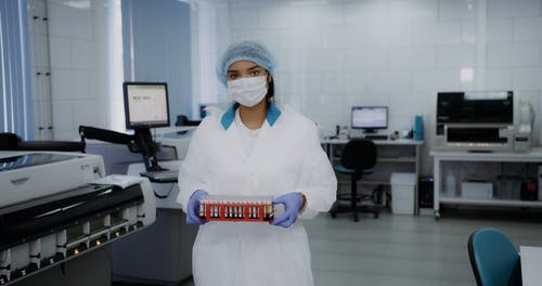 A Woman Holding a Tray of Blood Samples