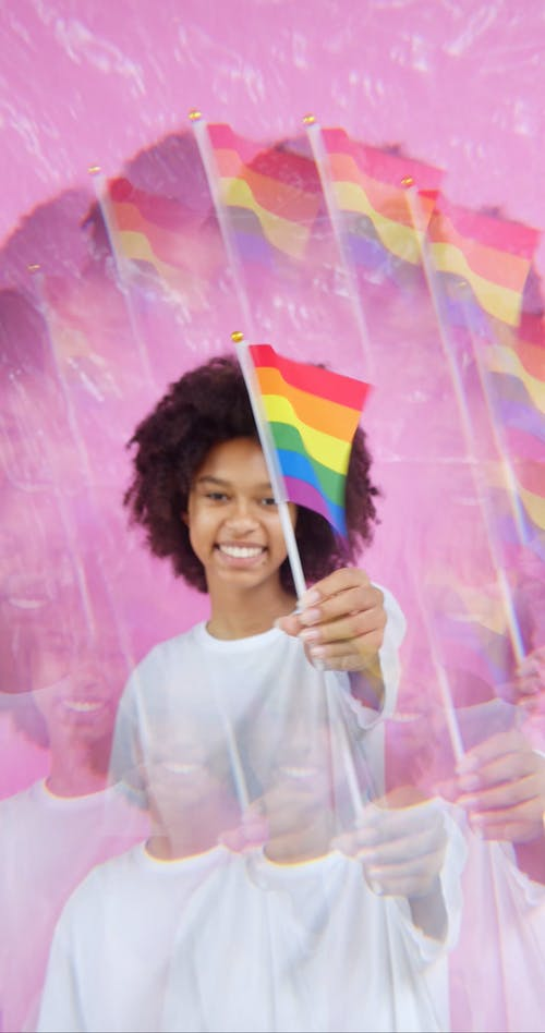 Happy Woman Waving a Rainbow Flag