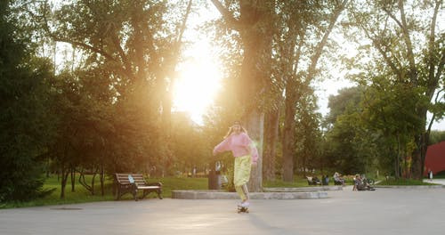 Fashionable Woman Riding a Skateboard