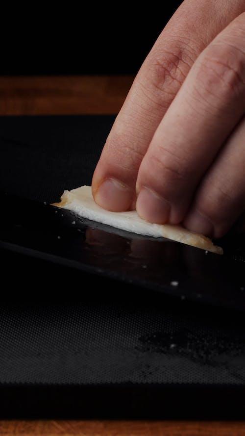 A Person Preparing Seafood Sashimi