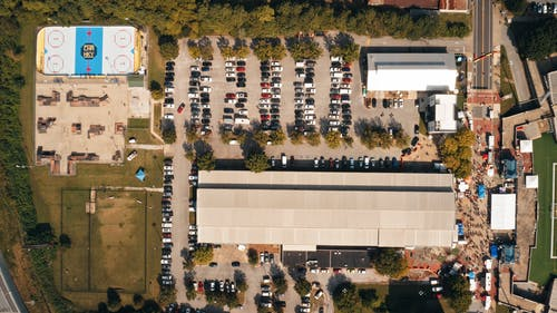 Aerial Time Lapse of Building with Parking Lot