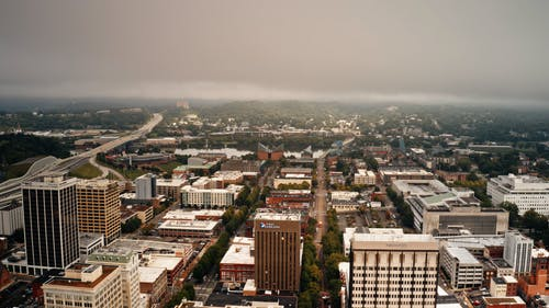 Drone Hyperlapse of City Under Overcast Sky