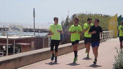 Group Of People Jog Together