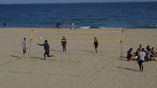 People Playing Volleyball At The Beach